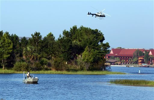 Florida Fish and Wildlife and an Orange County Sheriffs helicopter search for a toddler early Wednesday, June 15, 2016, after the boy was dragged into the water Tuesday night by an alligator.