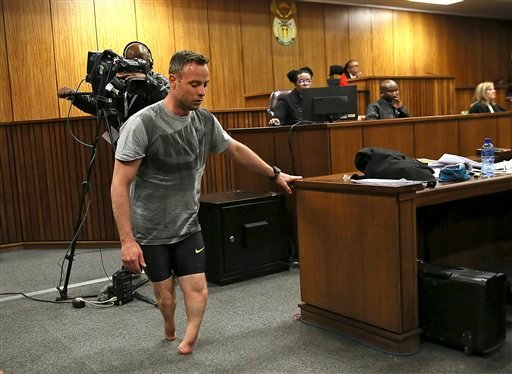 Oscar Pistorius walks on his stumps during argument in mitigation of sentence by his defense attorney Barry Roux in the High Court in Pretoria, South Africa, Wednesday, June 15, 2016.