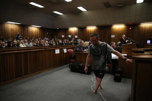 Oscar Pistorius, walks on his stumps during argument in mitigation of sentence by his defense attorney Barry Roux in the High Court in Pretoria, South Africa, Wednesday, June 15, 2016.