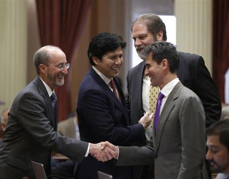 Both houses of the legislature voted to approved the $122.5 billion spending plan sending it to Democratic Gov. Jerry Brown who is expected to sign it into law. Second from right is Sen. John Moorlach, R-Costa Mesa. (AP Photo/Rich Pedroncelli)