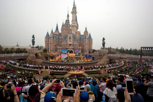 Performers take to the stage during the opening ceremony for the Disney Resort in Shanghai, China, Thursday, June 16, 2016.