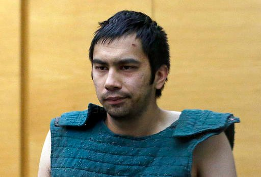 In this June 6, 2014, file photo, shooting suspect Aaron Ybarra is led to a court hearing at a King County Jail courtroom in Seattle, Wash.