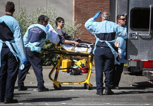 In this June 5, 2014, file photo, Jon Meis is taken from the scene by medics after a shooting at Seattle Pacific University in Seattle.