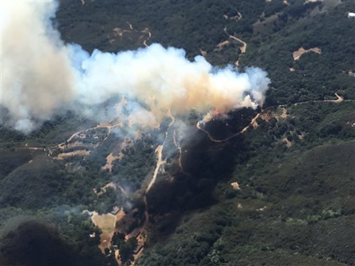 This photo provided by Los Padres Forest Aviation and KEYT-TV shows a wildfire burning in Los Padres National Forest, north of Santa Barbara, on Wednesday, June 15, 2016, in Goleta, Calif.