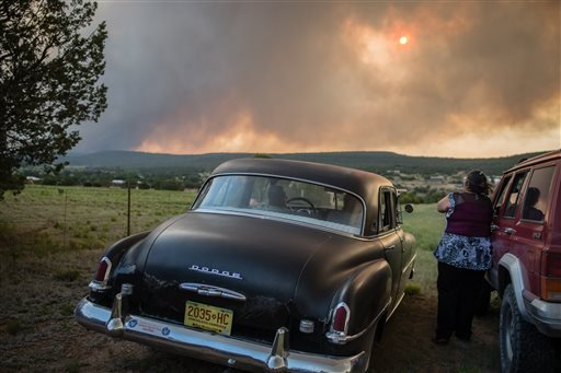 Residents of the town, Chilili, along state road 337 watch as the Dog Head Fire inches closer to their town, southeast of Albuquerque, N.M., Wednesday June 15, 2016.