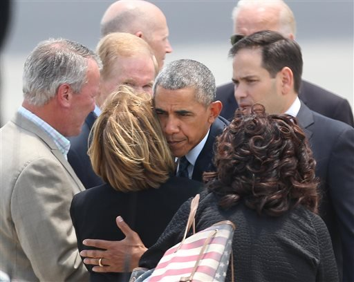 President Barack Obama hugs Orange County Mayor Teresa Jacobs upon the president's arrival at Orlando International Airport, Thursday, June 16, 2016, in Orlando, Fla.