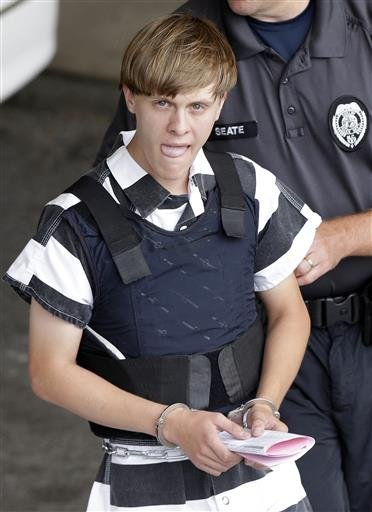 In this Thursday, June 18, 2015, file photo, Charleston, S.C., shooting suspect Dylann Storm Roof is escorted from the Cleveland County Courthouse in Shelby, N.C.