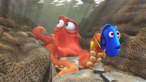 "This image released by Disney shows the characters Hank, voiced by Ed O'Neill, left, and Dory, voiced by Ellen DeGeneres, in a scene from ""Finding Dory."""