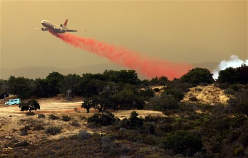 A DC-10 makes a drop on the east flank of the Sherpa Fire in Santa Barbara County, Calif., Friday, June 17, 2016.