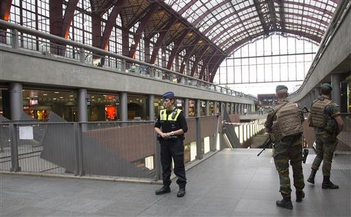 Police and Belgian Army soldiers guard a cordon at Antwerp Central train station in Antwerp, Belgium on Saturday, June 18, 2016.