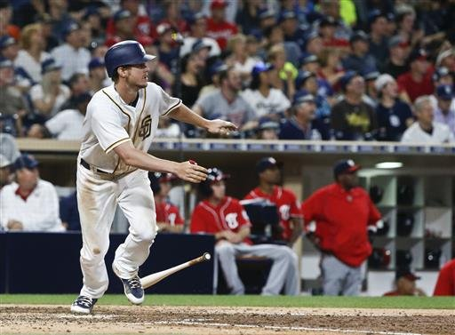 San Diego Padres' Wil Myers heads up the first base line after driving a bases loaded double to center field against the Washington Nationals that brought in two run in the eighth inning of a baseball game Saturday, June 18, 2016, in San Diego. Myers also