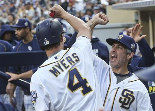 San Diego Padres' Wil Myers (4) bumps forearms with hitting coach Alan Zinter after hitting a solo home run against the Washington Nationals in the first inning of a baseball game Saturday, June 18, 2016, in San Diego. (AP Photo/Lenny Ignelzi)