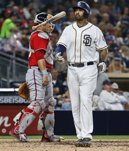 San Diego Padres' Matt Kemp flips his bat after striking out with a runner on base during the sixth inning of a baseball game against the Washington Nationals on Saturday, June 18, 2016, in San Diego. (AP Photo/Lenny Ignelzi)