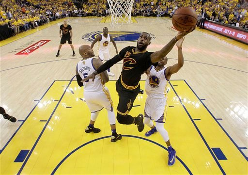 Cleveland Cavaliers forward LeBron James (23) shoots against the Golden State Warriors during the first half of Game 7 of basketball's NBA Finals in Oakland, Calif., Sunday, June 19, 2016.