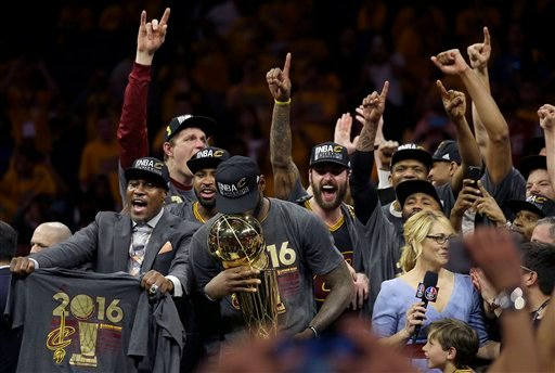 Cleveland Cavaliers forward LeBron James, center, celebrates with teammates after Game 7 of basketball's NBA Finals against the Golden State Warriors in Oakland, Calif.