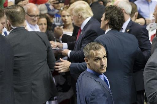 In this April 18, 2016 file photo, Republican presidential candidate Donald Trump's campaign manager Corey Lewandowski walks a rope line as the candidate signs autographs during a campaign stop at the First Niagara Center in Buffalo, N.Y. Trump has forced