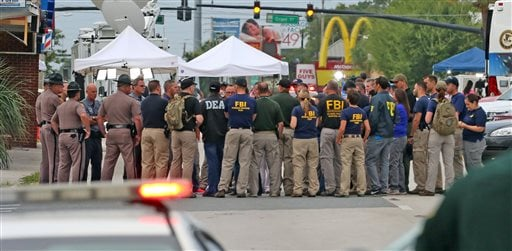 Multiple law enforcement agencies gather early Monday, June 20, 2016, in front of Pulse Nightclub at the mass shooting scene in Orlando. Federal investigators promised to provide more insight as to what was happening inside the Pulse nightclub after a gun