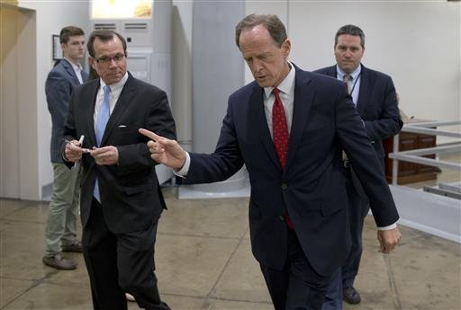 Sen. Patrick Toomey, R-Pa., center, walks towards the Senate on Capitol Hill, Monday, June 20, 2016 in Washington.