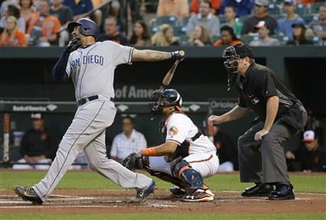 San Diego Padres' Matt Kemp, left, singles in front of Baltimore Orioles catcher Francisco Pena and home plate umpire Chris Conroy in the first inning of an interleague baseball game in Baltimore, Tuesday, June 21, 2016. Travis Jankowski scored on the pla