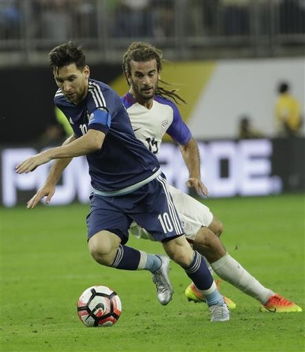 (AP Photo/David J. Phillip). Argentina midfielder Lionel Messi (10) gets the ball past United States midfielder Kyle Beckerman (15) during a Copa America Centenario semifinal soccer match Tuesday, June 21, 2016, in Houston.