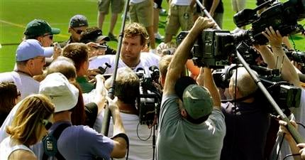 Pittsburgh Steelers quarterback Ben Roethlisberger, center, is swarmed by reporters and cameras after the first practice of their NFL football training camp in Latrobe, Pa., Saturday, Aug. 1, 2009. (AP Photo/Keith Srakocic)