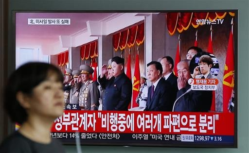 A woman walks by a public TV screen showing the North Korea's leader Kim Jong Un at the Seoul Train Station in Seoul, South Korea, Wednesday, June 22, 2016. In a remarkable show of persistence, North Korea on Wednesday fired two suspected powerful new Mus