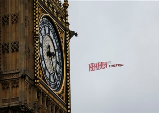 A pro-EU banner being towed behind a plane, passes the clock commonly known as Big Ben in Elizabeth Tower in the Houses of Parliament in London, Wednesday June 22, 2016 on the final day of the EU referendum campaign before Britain goes to the polls to vot