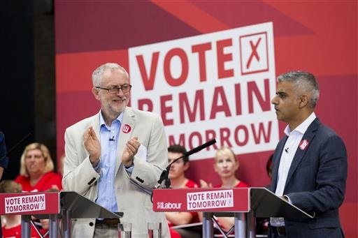 """The leader of Britain's opposition Labour Party Jeremy Corbyn, left, applauds London mayor Sadiq Khan as he makes an address during a European Referendum """"Remain"""" rally in London, Wednesday, June 22, 2016. Britain votes whether to stay in the European Uni"""