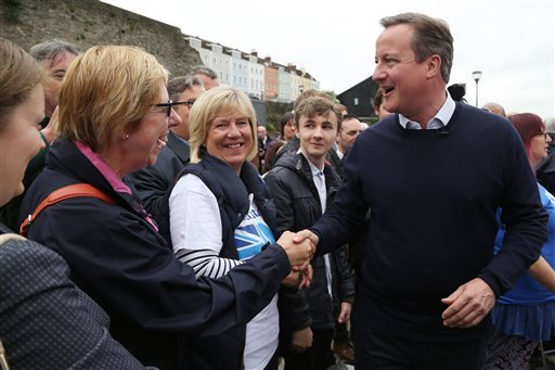 Britain's Prime Minister David Cameron meets supporters on a walkabout after he addressed a Vote Remain rally in Bristol, England Wednesday June 22, 2016. On Thursday Britain goes to the polls in a referendum on whether to remain or leave the EU . (Geoff