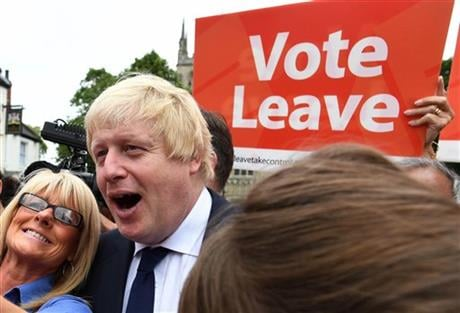Advocate to exit Europe Boris Johnson poses for a selfie photo with voters during a whistle stop tour of the country on the final day of campaigning before Thursday's EU referendum vote, in Selby, north England. AP