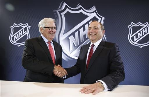 NHL Commissioner Gary Bettman, right, and Bill Foley pose for photographers during a news conference Wednesday, June 22, 2016, in Las Vegas.