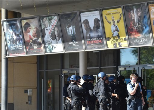 Police officers stand in front of a cinema in Viernheim near Mannheim, southern Germany, Thursday, June 23, 2016.