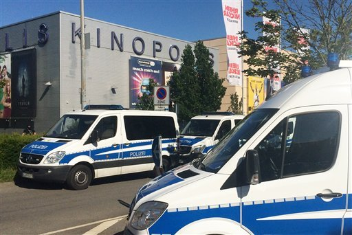 Police cars stand in front of a cinema in Viernheim near Mannheim, southern Germany, Thursday, June 23, 2016.