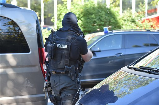 A special police force officer stands near a cinema in Viernheim near Mannheim, southern Germany, Thursday, June 23, 2016.