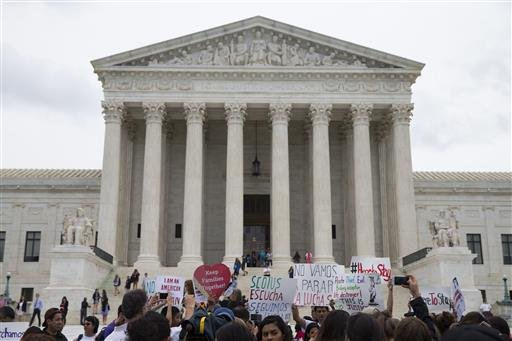 Demonstrators gather outside the Supreme Court in Washington, Thursday, June 23, 2016. In a major victory for affirmative action, a divided Supreme Court upheld the University of Texas admissions program that takes account of race. The justices voted in f