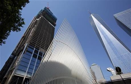the latest addition to the World Trade Center, the 80-story 3 World Trade Center, left, has reached it's highest point in New York. It is next to the Transportation Hub, center, and One World Trade Center, right. (AP Photo/Mark Lennihan)