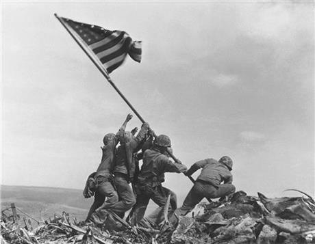 1945 file photo, U.S. Marines of the 28th Regiment, 5th Division, raise the American flag atop Mt. Suribachi, Iwo Jima, Japan. AP