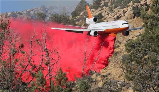 The 10 Tanker Air Carrier DC-10 drops a load of fire retardant on the Erskine fire near Lake Isabella, Calif., Thursday, June 23, 2016.