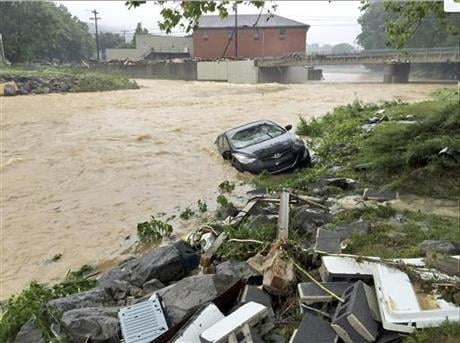 Multiple fatalities have been reported in flooding that has devastated parts of the state, a state official said Friday morning. ( Justin Michaels/The Weather Channel via AP)