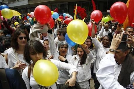 People celebrated celebrate the agreement between Revolutionary Armed Forces of Colombia, FARC, and Colombia's government, in Bogota, Colombia, Thursday, June 23, 2016.