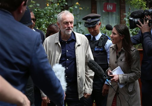 Labour party leader Jeremy Corbyn faces the media as he leaves his house in London, Sunday June 26, 2016. Corbyn seems to be facing a revolt by some members of his shadow cabinet, as a string of shadow ministers have quit Sunday citing his leadership duri