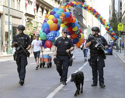 Heavily armed police officers walk along the street near the parade route of the New York City Pride Parade on Sunday, June 26, 2016, in New York City. A year after New York City's storied gay pride parade celebrated a high point with the legalization of