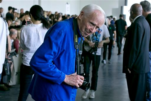 This Sept. 5, 2014 photo shows New York Times photographer Bill Cunningham arriving for the Jason Wu Spring 2015 collection during Fashion Week in New York. Cunningham, a longtime fashion photographer for The New York Times known for taking pictures of ev
