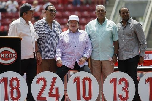 Former Cincinnati Reds player Pete Rose, center, sits with Reds greats, from left to right, Johnny Bench, Tony Perez, Dave Concepcion and Barry Larkin during a ceremony to retire his No. 14 before a baseball game against the San Diego Padres, Sunday, June