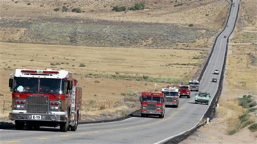 A strike team of five engines head to the Erskine Fire, Saturday, June 25, 2016 in the Hanning Flat area near Isabella Lake, Calif. (Casey Christie (/The Bakersfield Californian via AP)