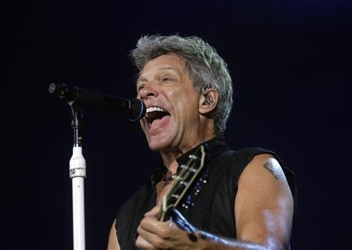 "In this Sept. 11, 2015 file photo, Bon Jovi's lead singer Jon Bon Jovi performs during their ""Bon Jovi Live!"" concert at Gelora Bung Karno Stadium in Jakarta, Indonesia, on their Asia tour. A New Jersey woman battling lung cancer has received an unforgett"