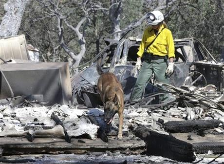 The blaze had killed an elderly couple who were found Friday after apparently being overcome by smoke. The fire has burned more than 70 square miles and is 40 percent contained. (AP Photo/Rich Pedroncelli)