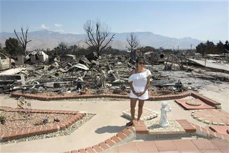 Gibson returned to her home to search for her missing dogs that were at the house when fire swept through her neighborhood near Lake Isabella, Calif. More than 200 homes and other structures were destroyed by the fire. (AP Photo/Rich Pedroncelli)