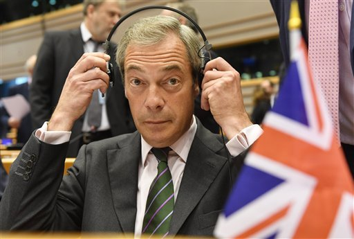 Leader of the UKIP Nigel Farage sits behind a British flag during a special session of European Parliament in Brussels on Tuesday, June 28, 2016.