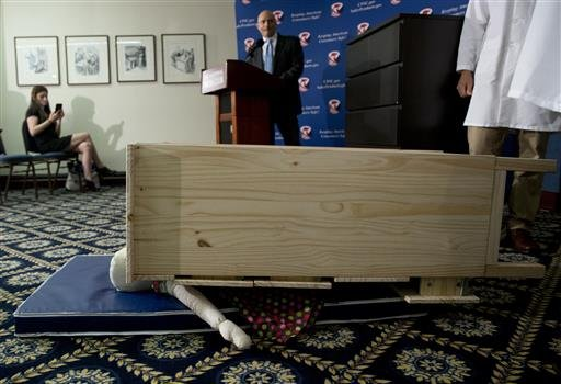 Consumer Product Safety Commission (CPSC) Chairman Elliot Kaye watches during a demonstration of how an Ikea dresser can tip and fall on a child during a news conference at the National Press Club in Washington, Tuesday, June 28, 2016.